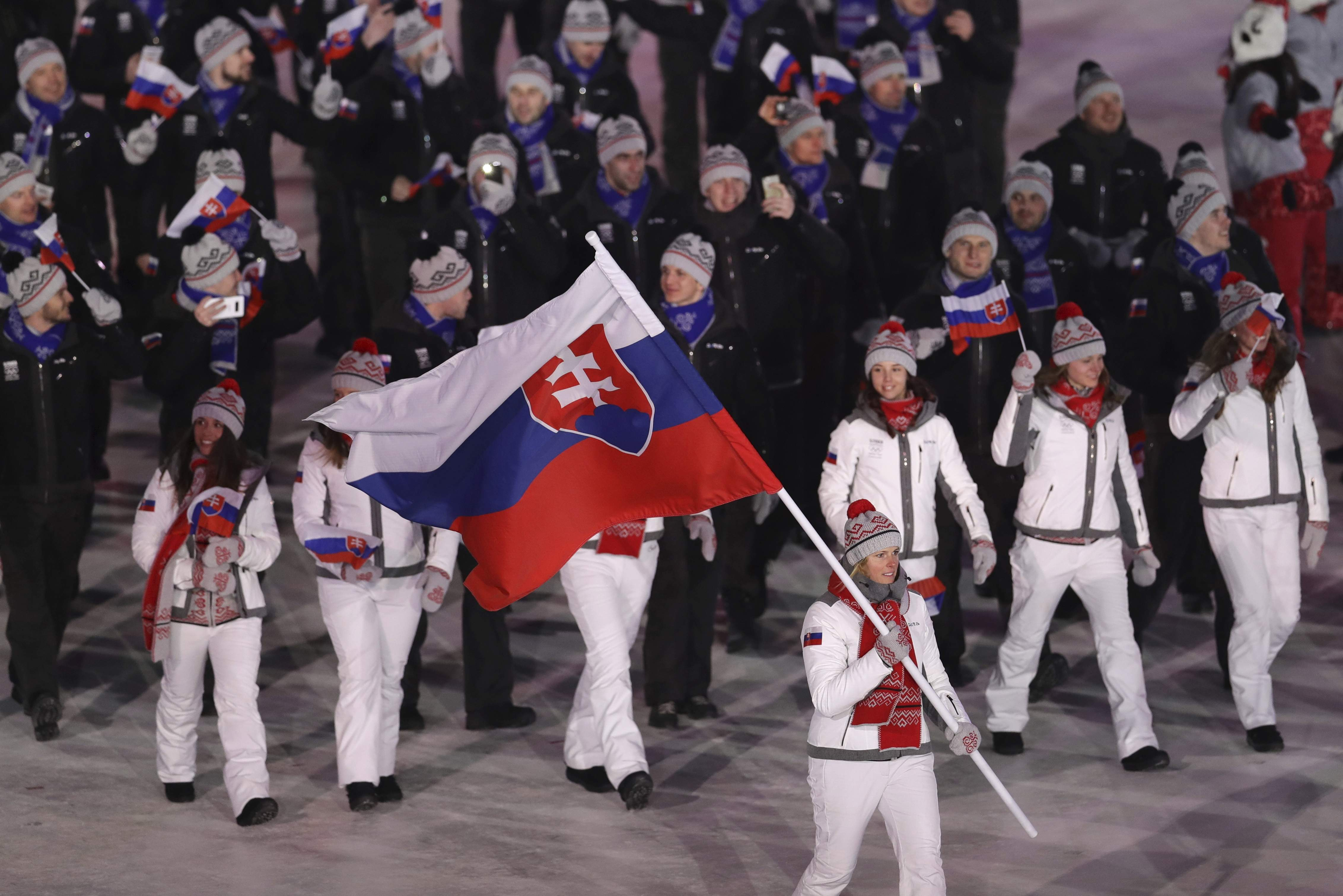 Veronika Velez Zuzulova carries the flag of Slovakia during the opening ceremony of the 2018 Winter Olympics in Pyeongchang, South Korea, Friday, Feb. 9, 2018. (AP Photo/Michael Sohn)