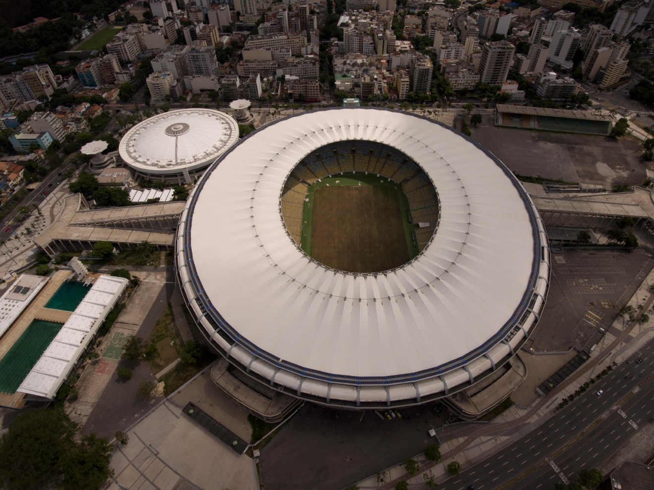 This Feb. 2, 2017 shows Maracana stadium with a dry field in Rio de Janeiro, Brazil. Stadium operators, the Rio state government, and Olympic organizers have fought over $1 million in unpaid electricity bills and management of the venue. (AP Photo/Silvia Izquierdo)
