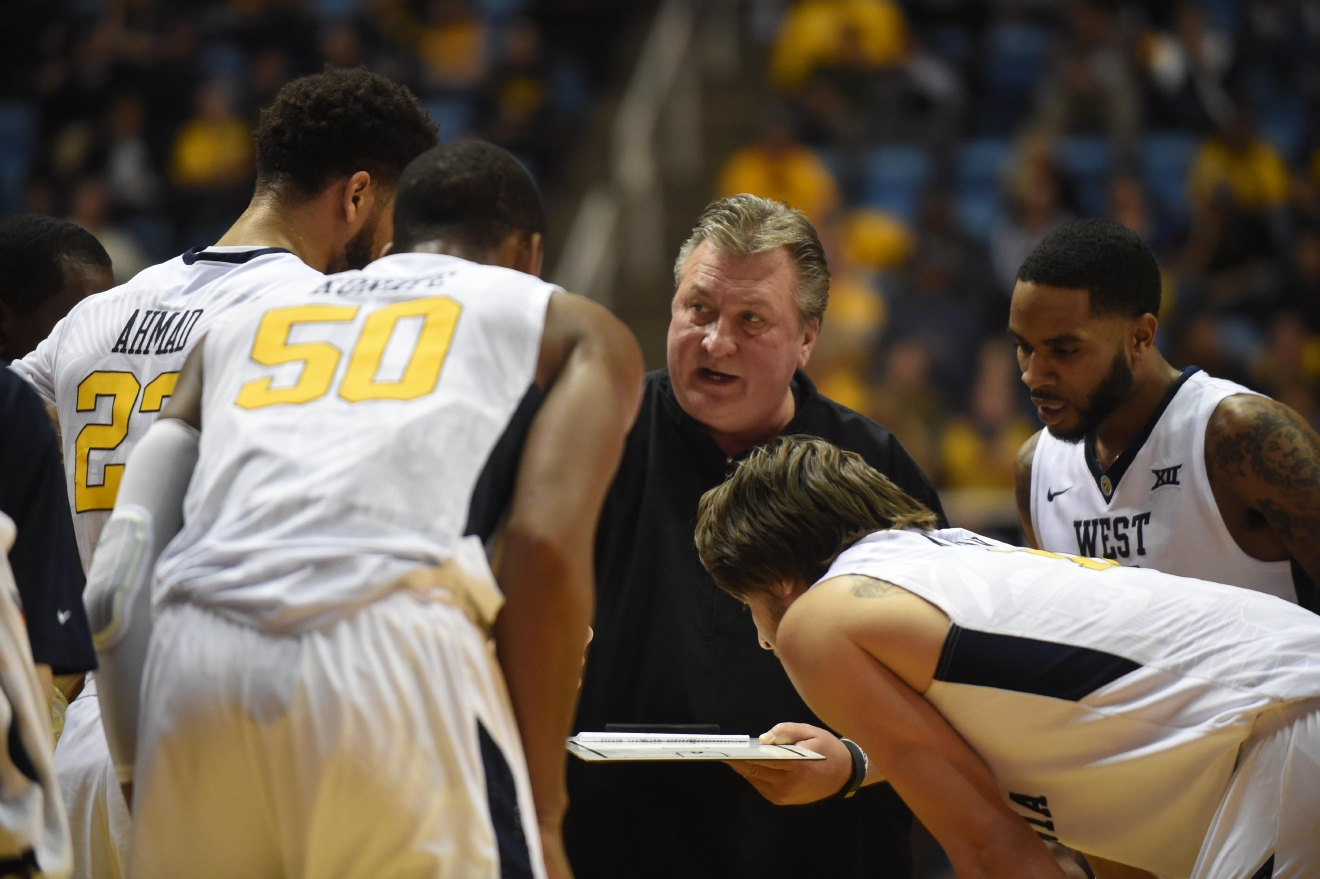 <p>Coming off a 28-win season, Bob Huggins' West Virginia Mountaineers men's basketball team will enter the 2017-18 season ranked inside the top 10. (Dale Sparks/WVU){&amp;nbsp;}</p><p><br></p>