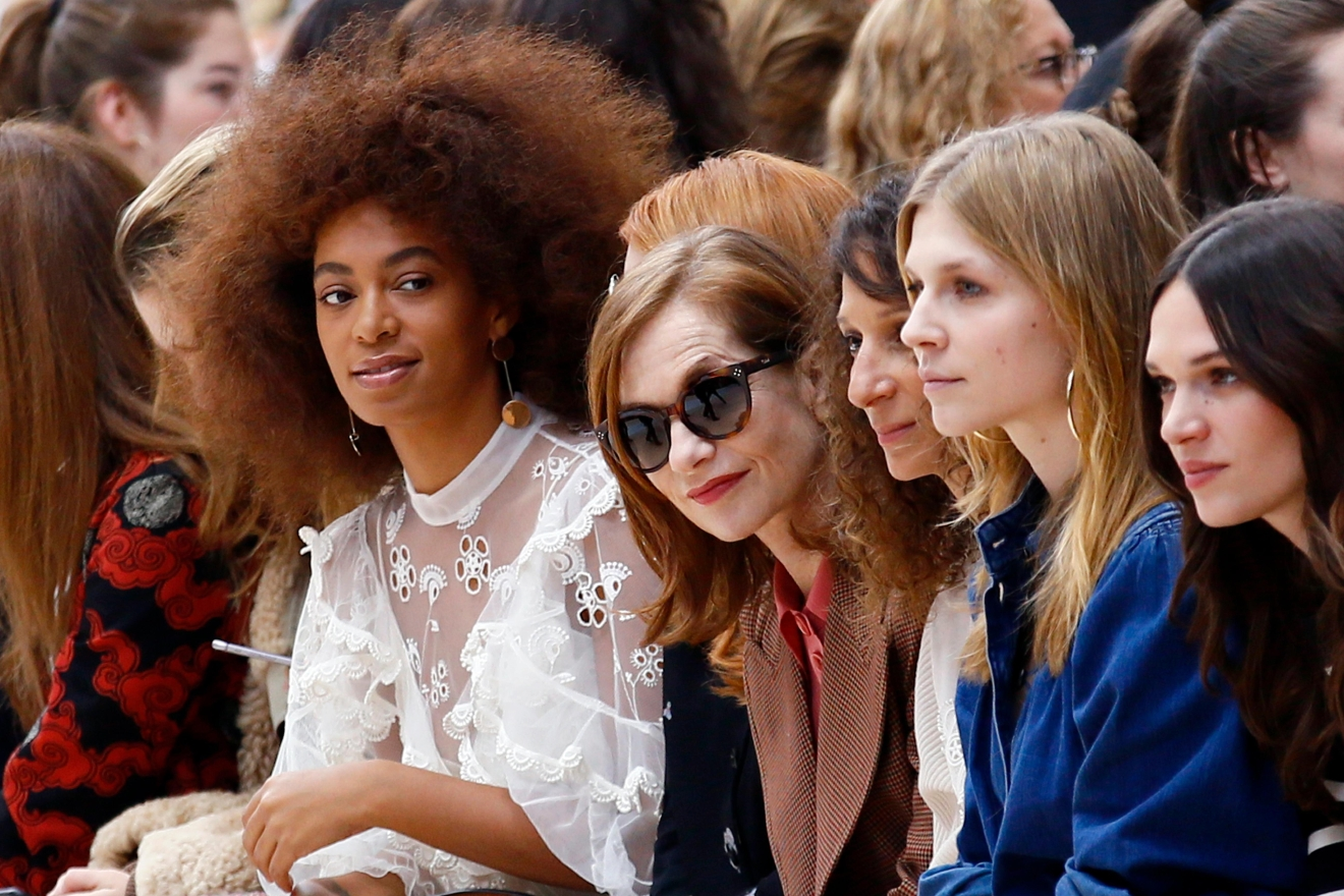 U.S singer Solange Knowles, left, and french actress Isabelle Huppert, second left, look on prior to the show for Chloe's Fall-Winter 2017-2018 ready to wear fashion collection presented in Paris, Thursday, March 2, 2017. (AP Photo/Francois Mori)