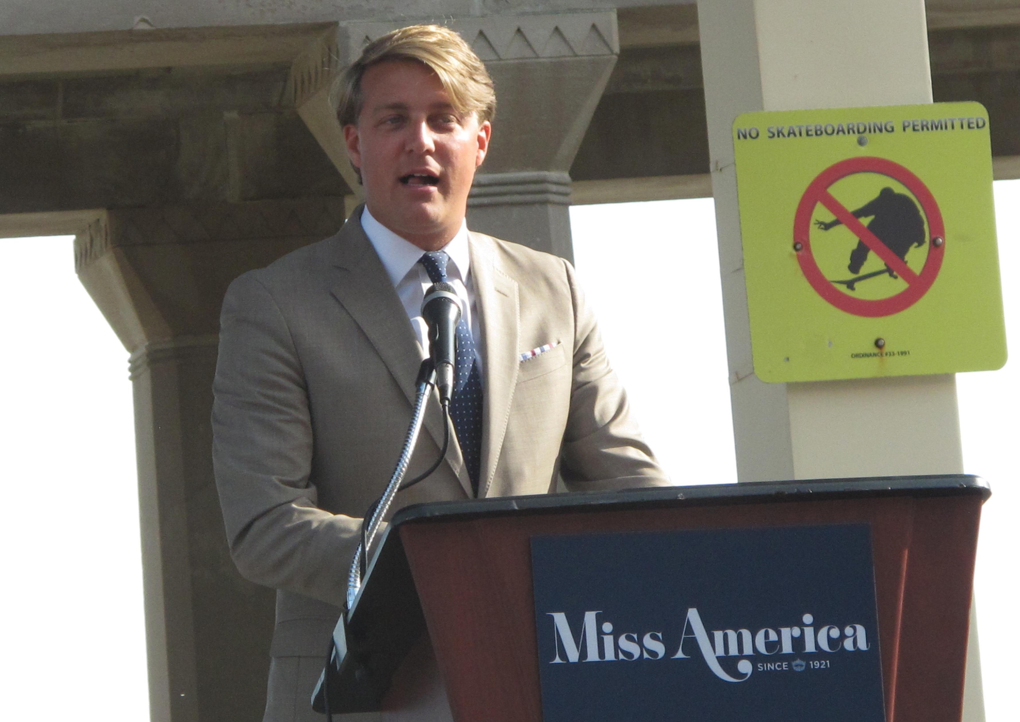 This Aug. 30, 2017 photo shows Josh Randle, president of the Miss America Organization, speaking at a welcoming ceremony for pageant contestants in Atlantic City N.J. On Saturday Dec. 23, 2017, Randle resigned from the organization in the wake of an email scandal in which top leaders of the group ridiculed former Miss Americas, including comments about their appearance, intellect and sex lives. The group's CEO was suspended on Friday. (AP Photo/Wayne Parry)