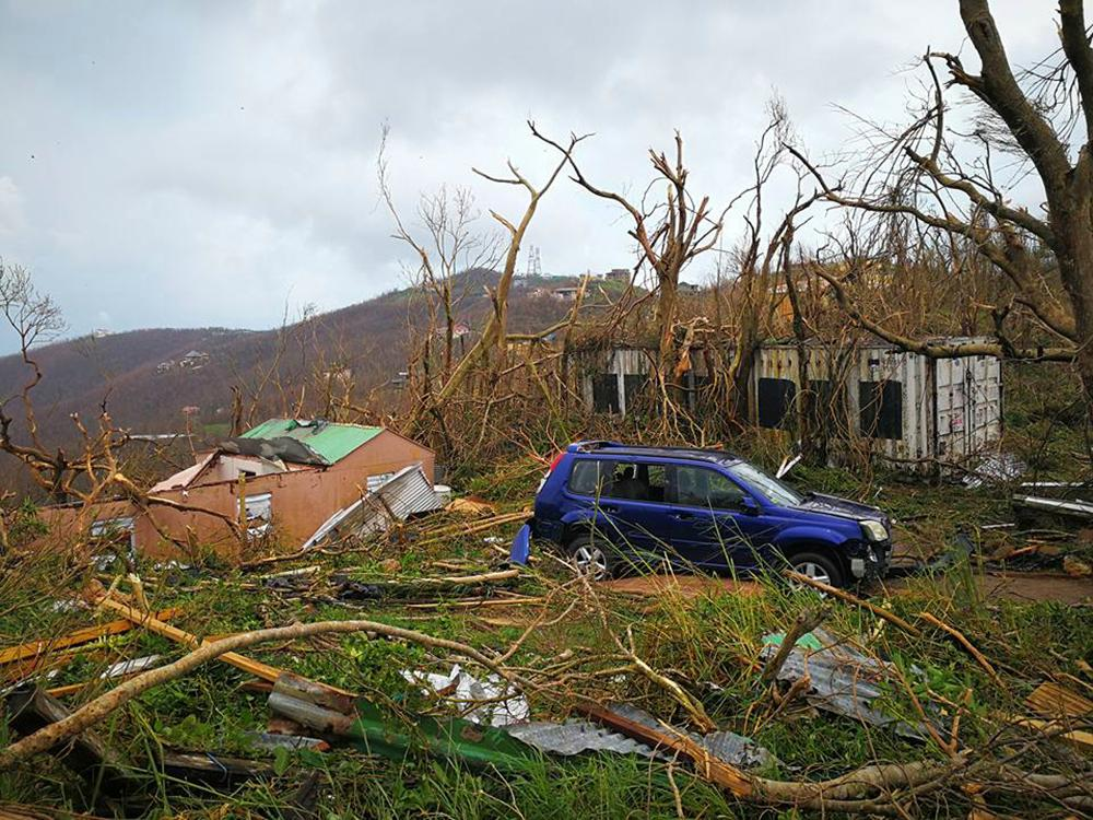 This Thursday, Sept. 7, 2017 photo shows storm damage in the aftermath of Hurricane Irma in Tortola, in the British Virgin Islands. Irma scraped Cuba's northern coast Friday on a course toward Florida, leaving in its wake a ravaged string of Caribbean resort islands strewn with splintered lumber, corrugated metal and broken concrete. (Jalon Manson Shortte via AP)