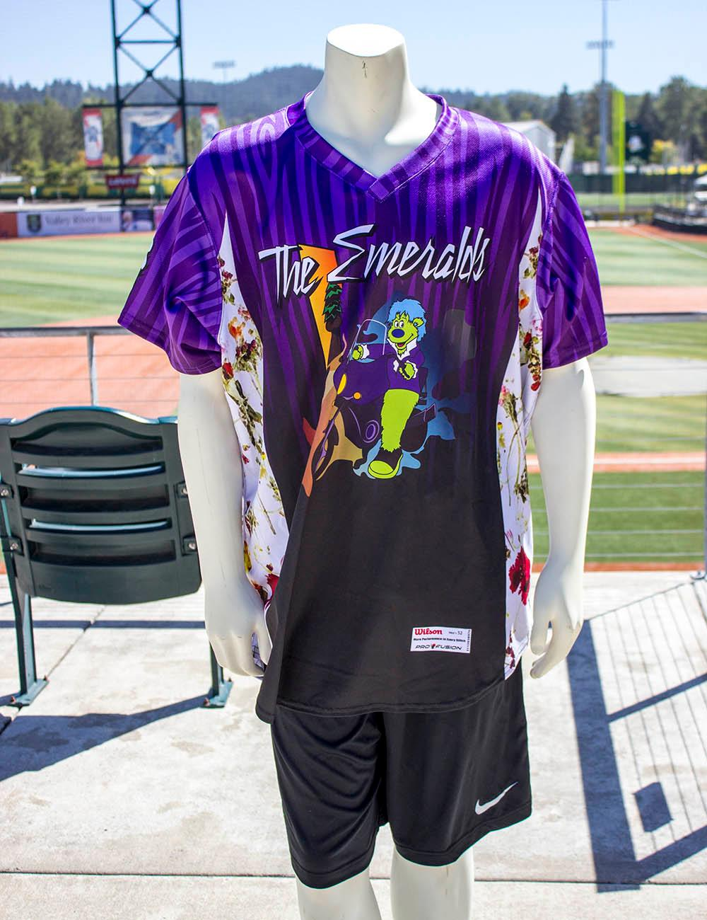 "Eugene Emeralds graphic designer Danny Cowley said the ""Purple Rain"" jersey was the second design he made after he was hired. The design wasn't produced that season, but after Prince died, the Ems general manager asked him to pull out the design and submit it for production. The Eugene Emeralds will hold a Throwback Thursday and Teacher Appreciation Night August 18. Teachers can get free box seats. (Photo by Amanda Butt)"