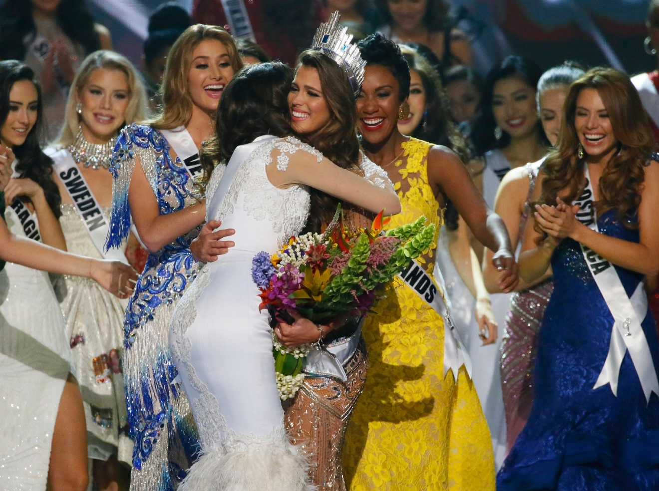 Iris Mittenaere, center right, of France is congratulated by fellow contestants shortly after being proclaimed the Miss Universe 2016 in coronation Monday, Jan. 30, 2017, at the Mall of Asia in suburban Pasay city, south of Manila, Philippines. (AP Photo/Bullit Marquez)