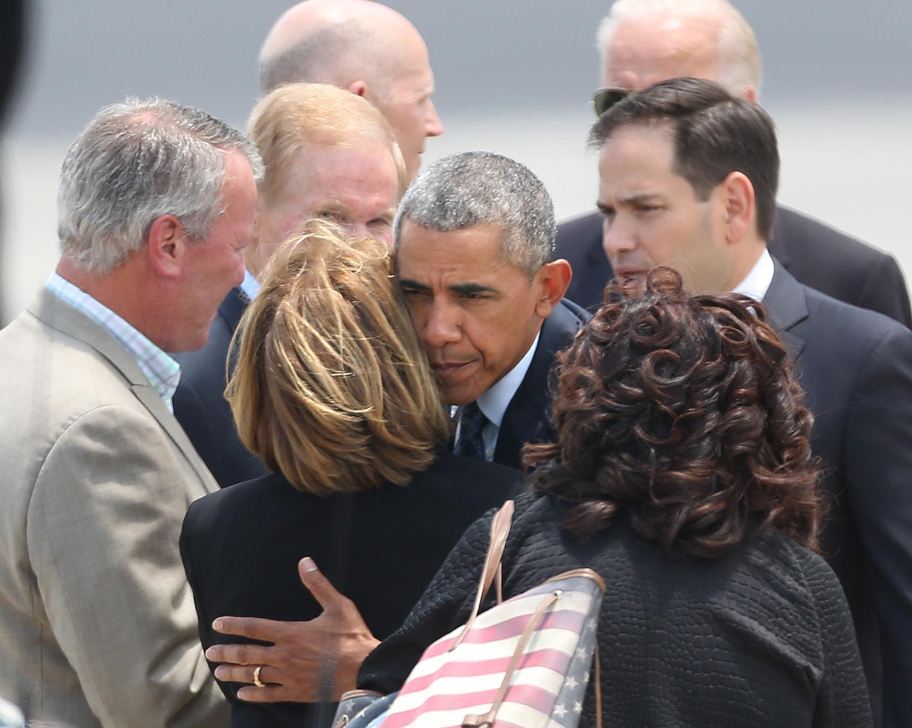 President Barack Obama hugs Orange County Mayor Teresa Jacobs upon the president's arrival at Orlando International Airport, Thursday, June 16, 2016, in Orlando, Fla. Obama is in Orlando today to pay respects to the victims of the Pulse nightclub shooting and meet with families of victims of the attack. (Stephen M. Dowell/Orlando Sentinel via AP) MAGS OUT; NO SALES; MANDATORY CREDIT