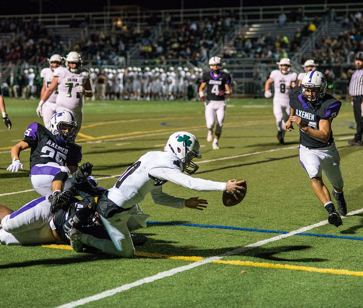Sheldon Irish Carter Helikson (#10) reaches for the goal line. Sheldon Irish defeated South Eugene Axemen 63-6 on Friday night at South Eugene Highschool in Eugene, Ore. Photo by Dan Morrison, Oregon News Lab