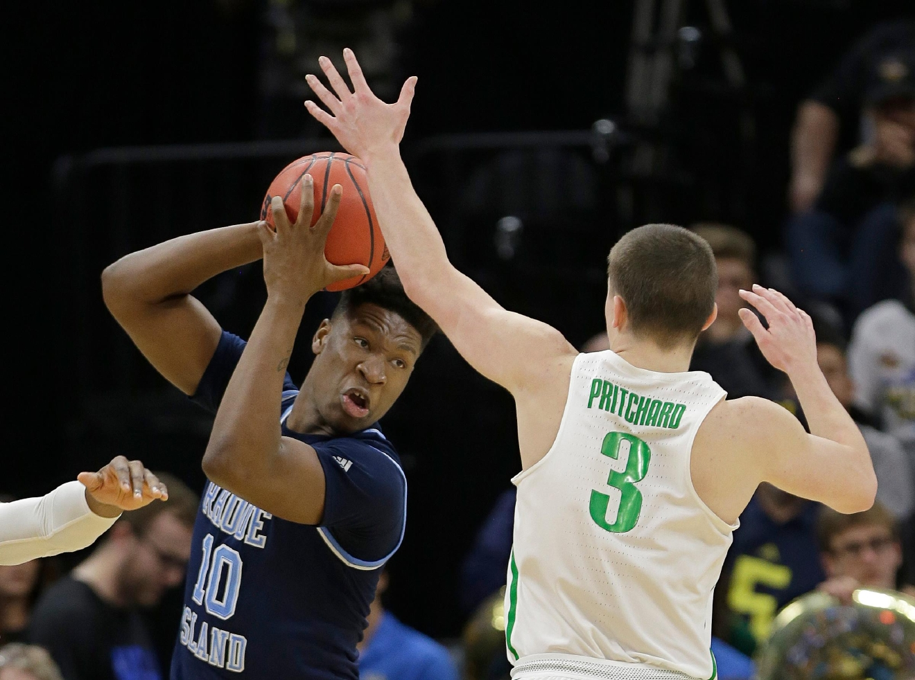 Oregon guard Payton Pritchard, right, guards Rhode Island forward Cyril Langevine during the first half of a second-round game of the men's NCAA college basketball tournament in Sacramento, Calif., Sunday, March 19, 2017. (AP Photo/Rich Pedroncelli )