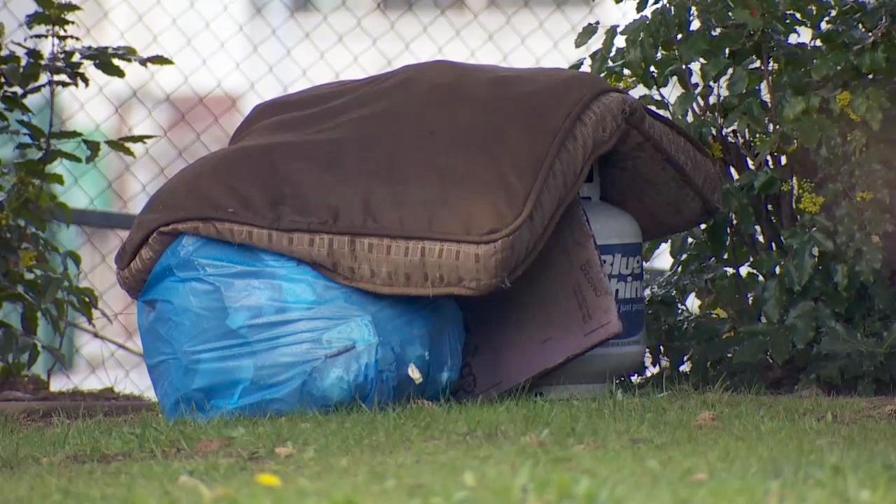 Items from homeless people litter a homeless camp south of Interstate 84 and north of Northeast 34th and Halsey. (KATU Photo)