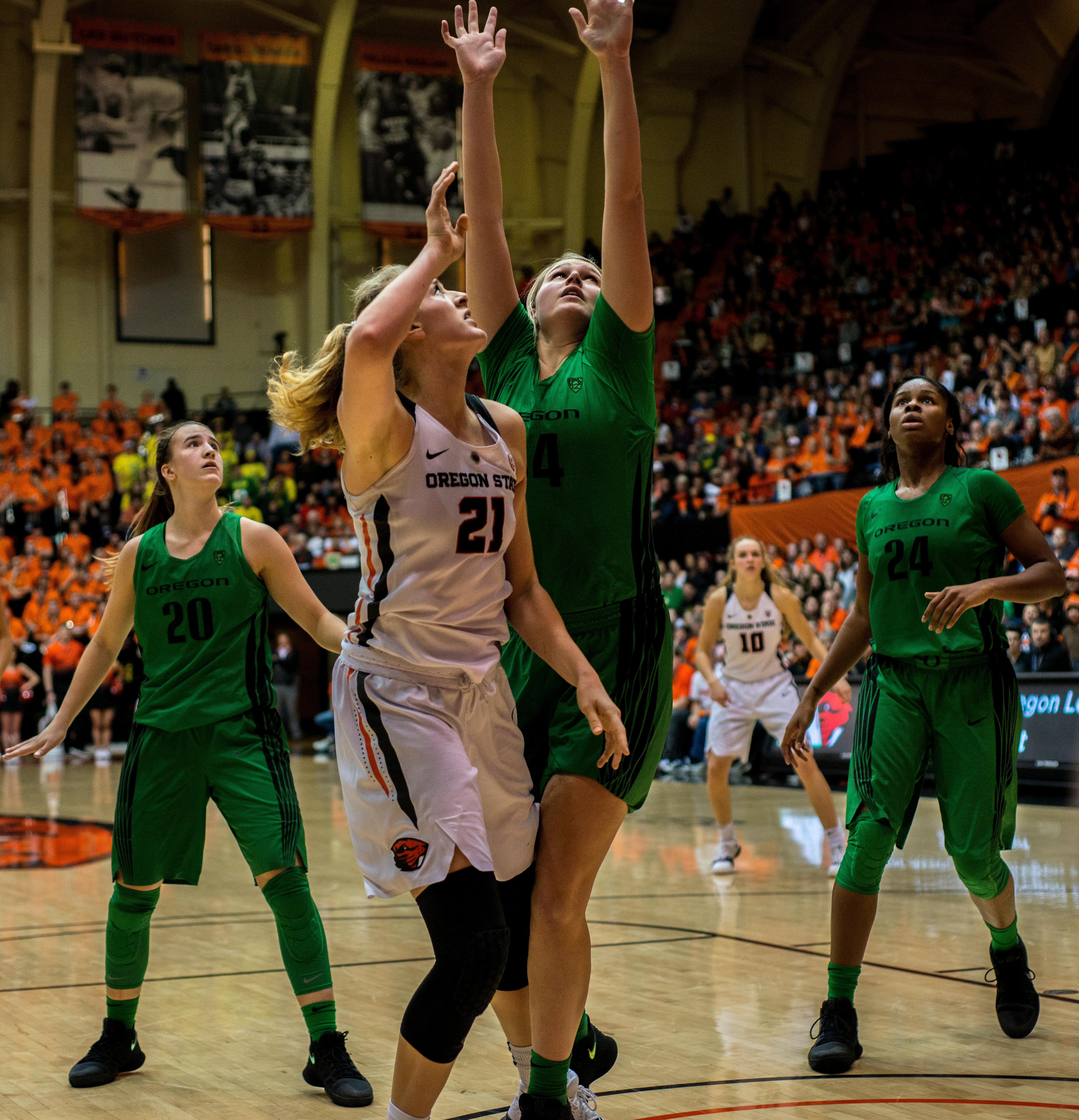 Oregon Ducks guard Sabrina Ionescu (#20) and forwards Ruthy Hebard(#24) and Mallory McGwire (#44) watch Oregon State Beavers forward Marie Gülich (#21) make a shot.The Oregon Ducks were defeated by the Oregon State Beavers 85-79 on Friday night in Corvallis. Sabrina Ionescu scored 35 points and Ruthy Hebard added 24. The Ducks will face the Beavers this Sunday at 5 p.m. at Matthew Knight Arena. Photo by Abigail Winn, Oregon News Lab