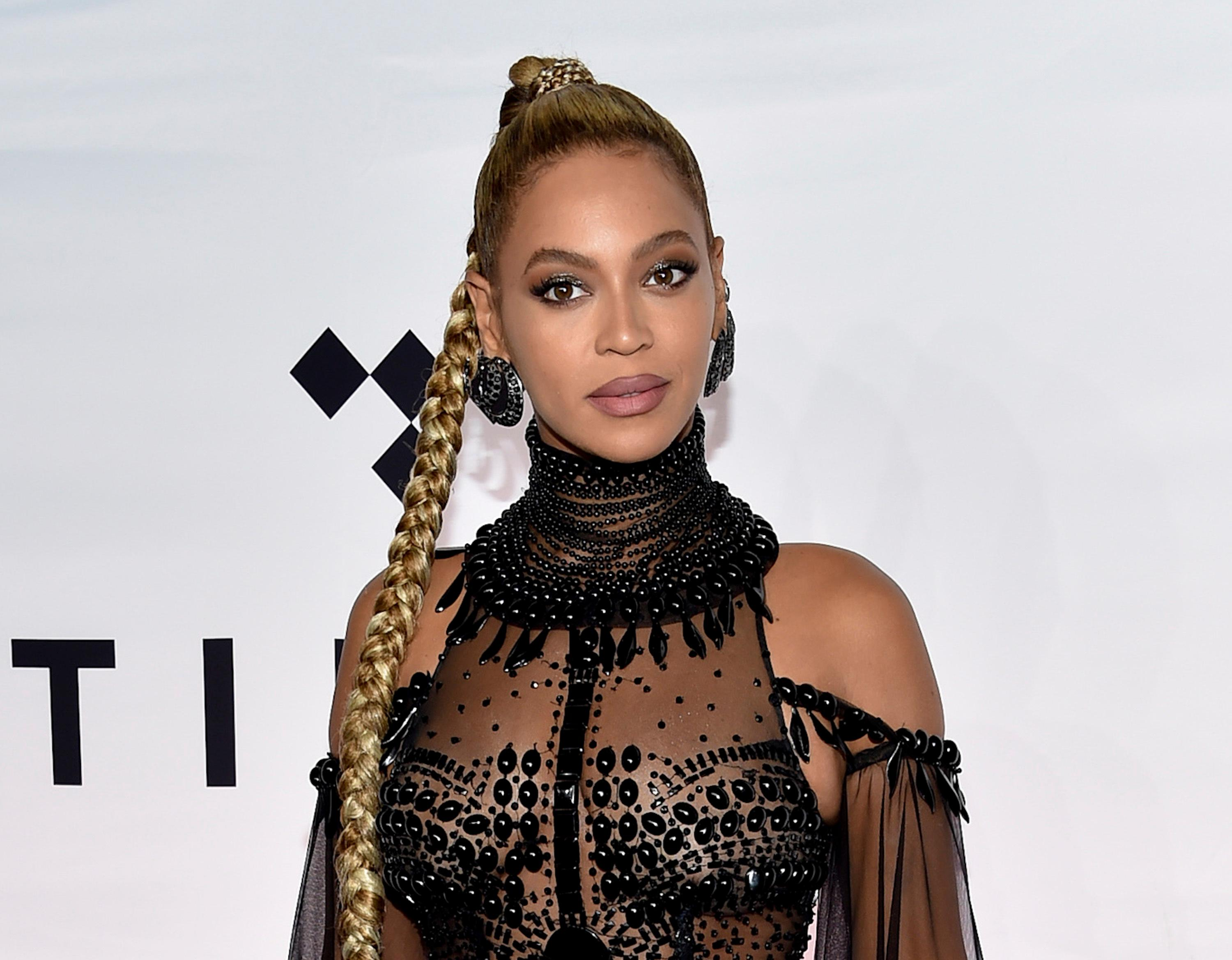 FILE - In this Oct. 15, 2016 file photo, singer Beyonce Knowles attends the Tidal X: 1015 benefit concert in New York. Beyonce is among 100 black luminaries being recognized by Ebony magazine. The magazine revealed its annual Power 100 list Friday, Nov. 4, which recognizes outstanding achievements by black entertainers, corporate heads and civic leaders. (Photo by Evan Agostini/Invision/AP, File)