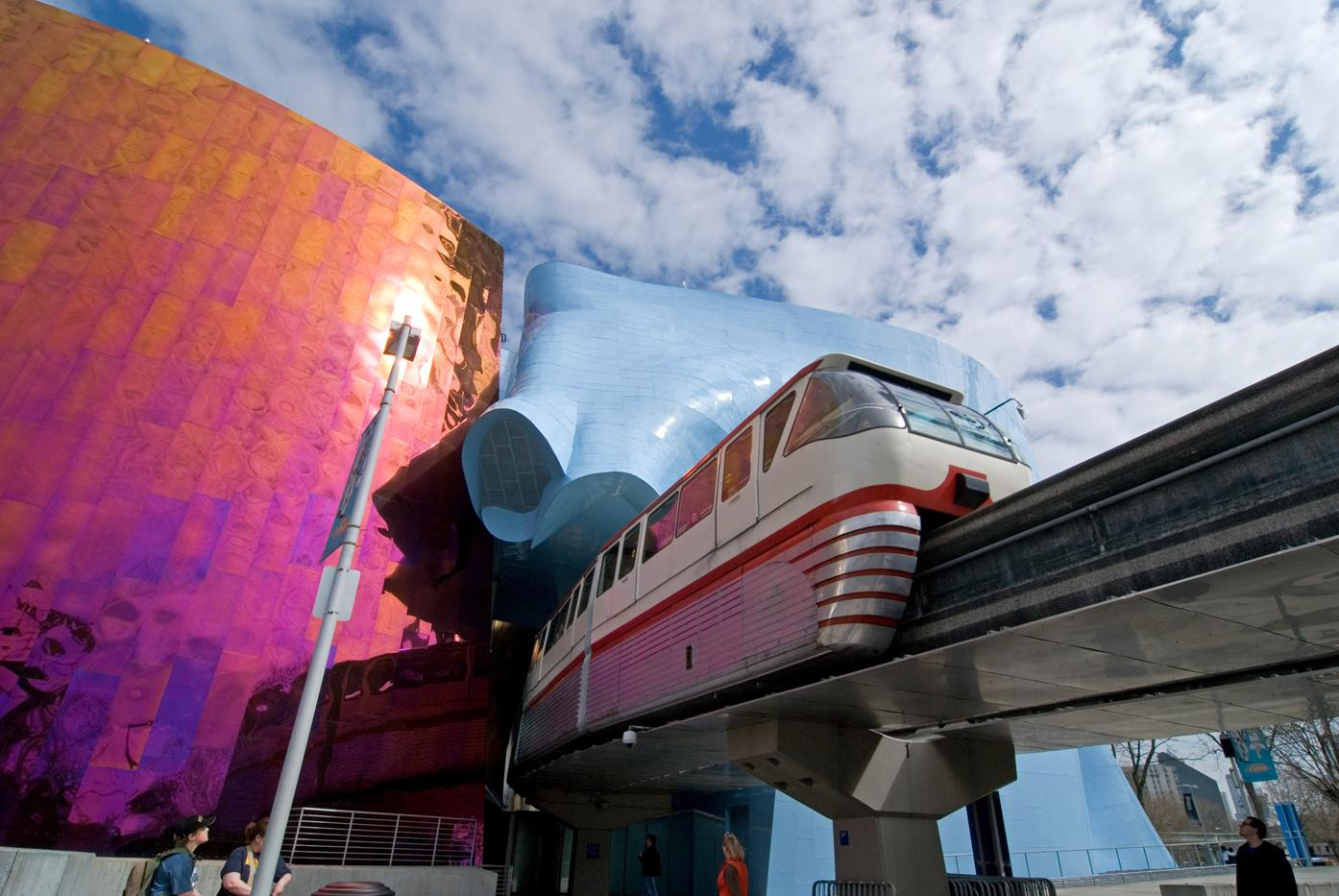 The Seattle Center Monorail passing through the Museum of Pop Culture. (Photo courtesy of Visit Seattle/Howard Frisk Photography)