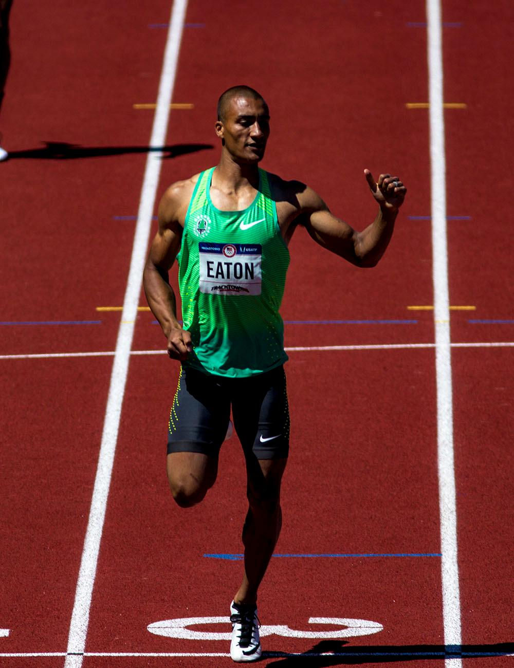 Nike Oregon Track Club's Ashton Eaton crosses the finish line of the Men�s 400m Dash as part of the Men�s Decathlon. He finished with a time of 46.30. He currently sits in first place after five events with a score of 4560. Day two of the U.S. Olympic trials track and field were held Saturday at Hayward Field in Eugene Ore. Events continue through July 10. (Photo by Amanda Butt)
