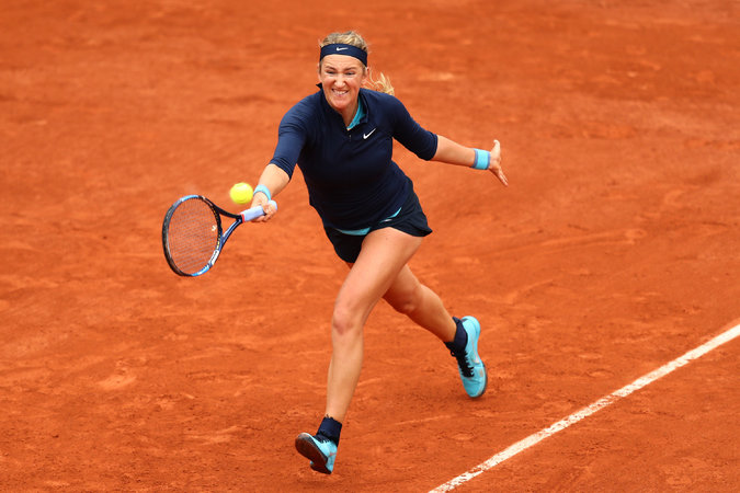 Azarenka playing in the first round of the 2016 French Open. She retired from the match with an injured knee and later learned that she was pregnant. Credit Julian Finney/Getty Images