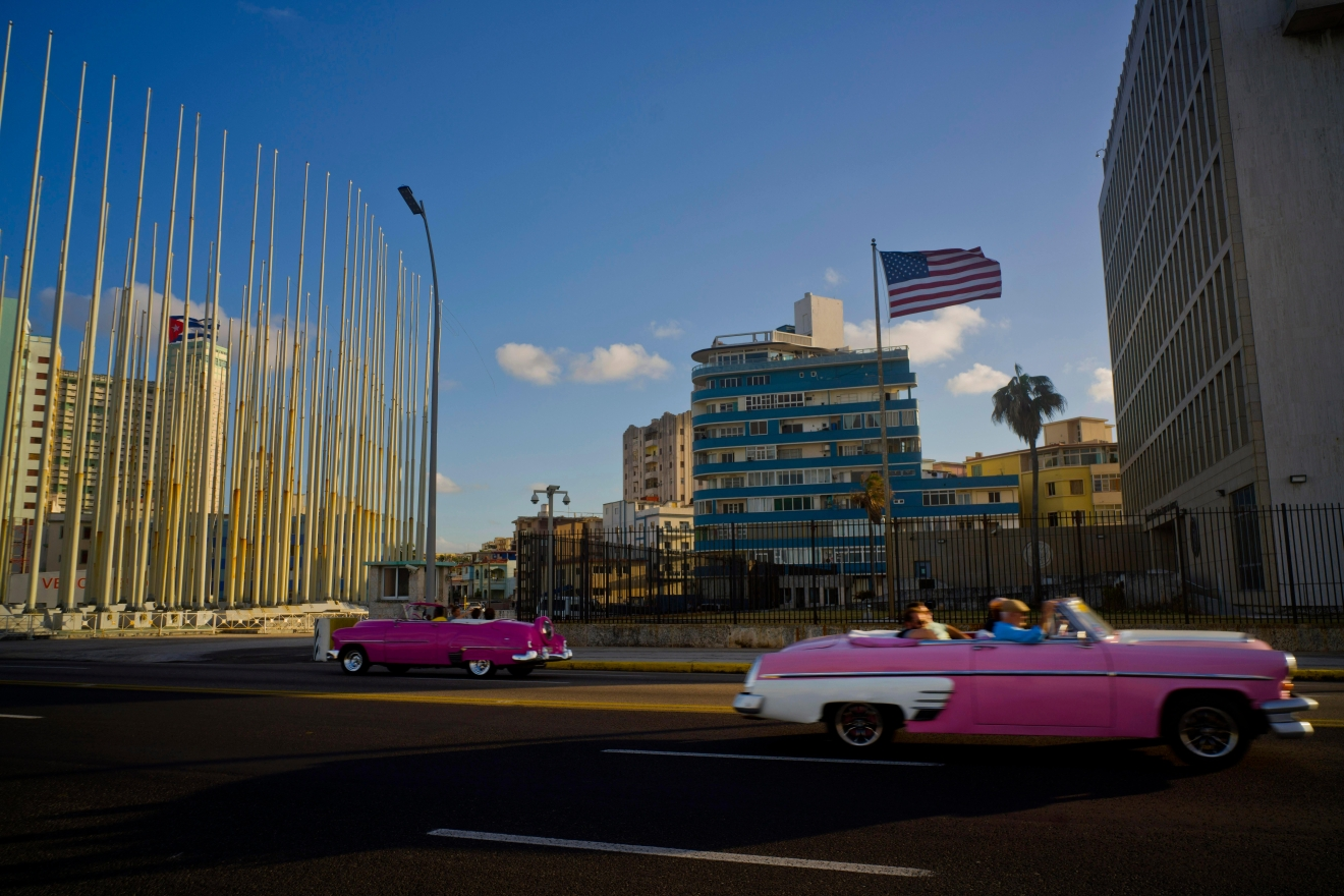 FILE -- Tourists ride in classic American convertible cars past the United States embassy, right, in Havana, Cuba, Thursday, Jan. 12, 2017.(AP Photo/Ramon Espinosa)
