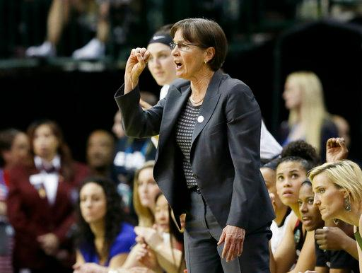 Stanford head coach Tara Vanderveer talks t her players during the second half of an NCAA college basketball game against South Carolina in the semifinals of the women's Final Four, Friday, March 31, 2017, in Dallas.(AP Photo/Tony Gutierrez)