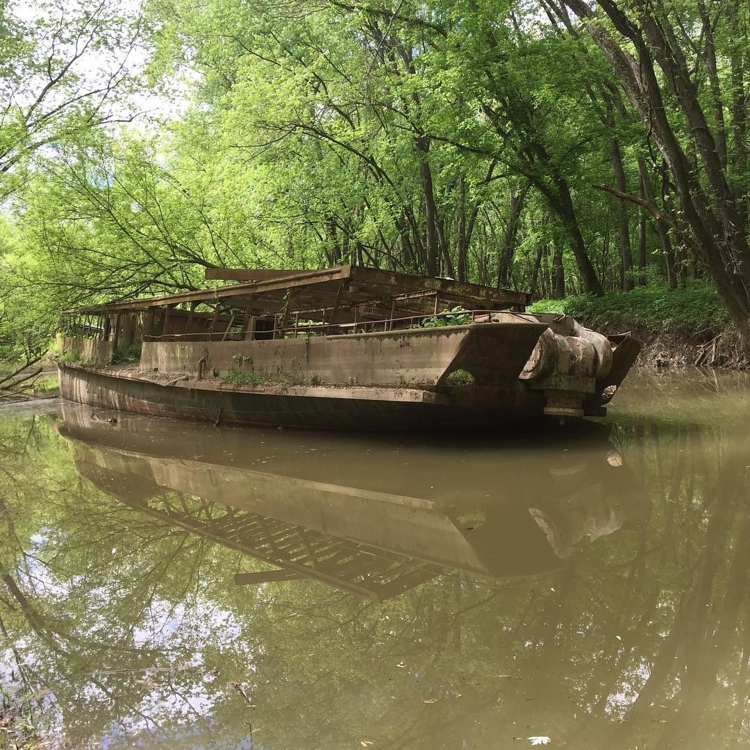 The Circle Line V was a ship that first launched in 1902, served numerous purposes, and subsequently came to rest on the banks of the Ohio River years later. For decades, the ship has been rusting beneath a canopy of trees, attracting visitors who want to see and photograph the hulking, metal boat. The ship sits on private property. / Image courtesy of Instagram user @Dreamsmasher502 // Published: 8.4.18