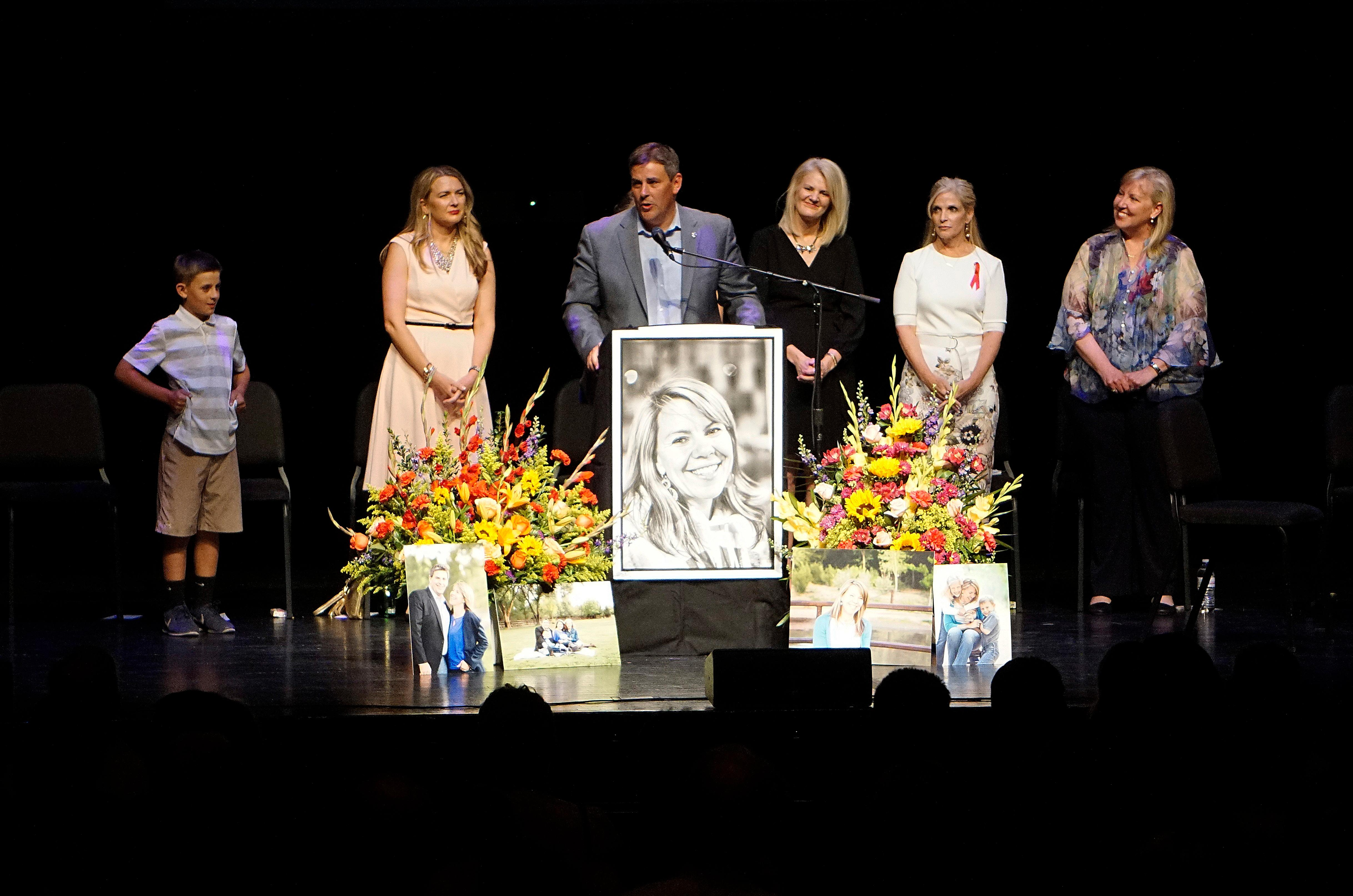 Michael Riordan, center, is joined by family members at a memorial service for his wife Jennifer Riordan, who died on Tuesday in the Southwest Airlines flight 1380 accident, at Popejoy Hall on the campus of the University of New Mexico in Albuquerque, N.M., Sunday, April 22, 2018. (Adolphe Pierre-Louis/The Albuquerque Journal via AP)