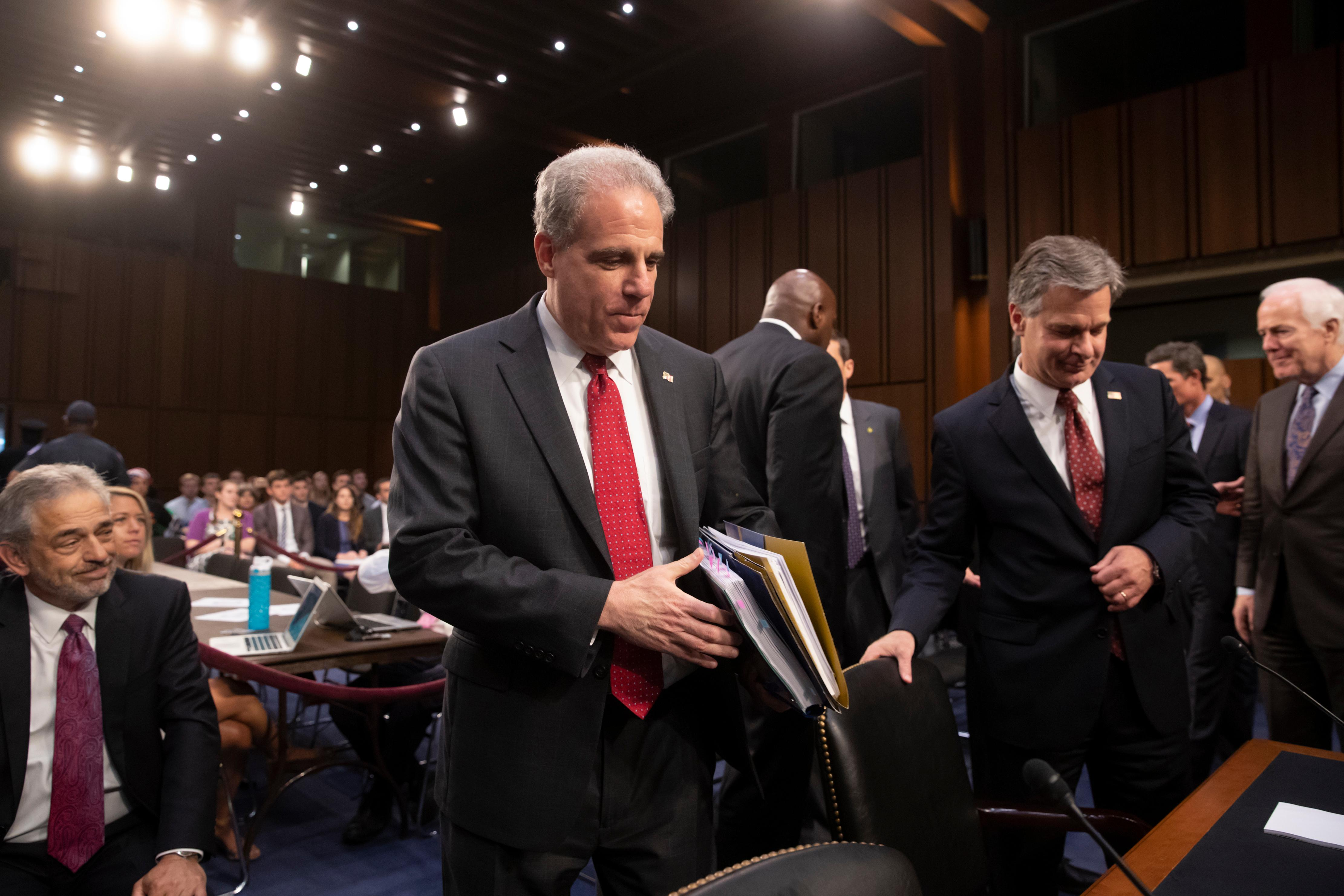Justice Department Inspector General Michael Horowitz, center, and FBI Director Christopher Wray, right arrive to testify as the Senate Judiciary Committee examines the internal report of the FBI's Clinton email probe and the role of former FBI Director James Comey's actions during the 2016 presidential campaign, on Capitol Hill in Washington, Monday, June 18, 2018. (AP Photo/J. Scott Applewhite)